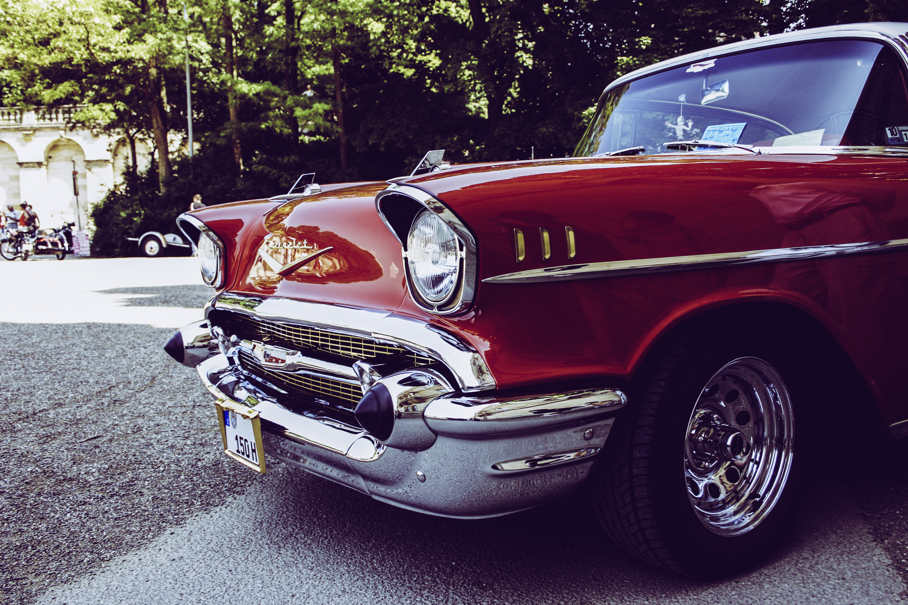red and gray vintage car on gray concrete road during daytime - Classic Car Colors