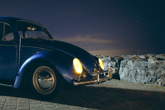 Blue Volkswagen Beetle Car Near Cliff during Night Time