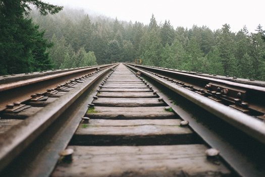 Brown Steel Train Rail during Daytime