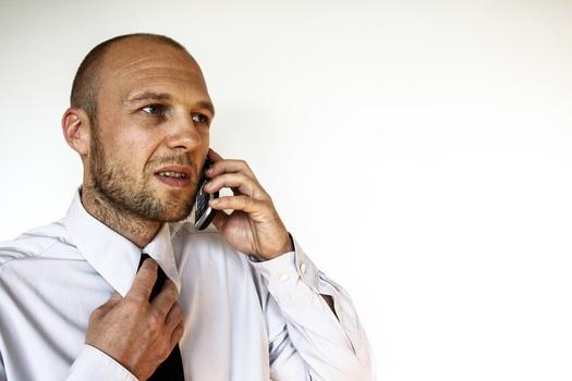 Man Wearing White Dress Shirt Holding Smartphone