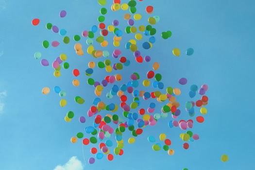 Blue Green Orange Yellow and Red Balloons on Blue Sky