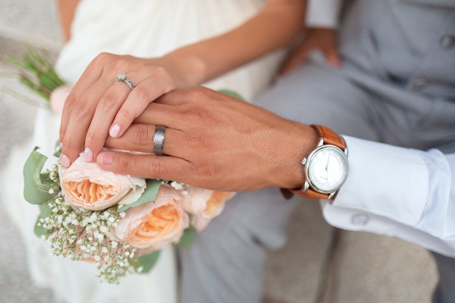 Man in Silver Wedding Ring Touching Peach Roses