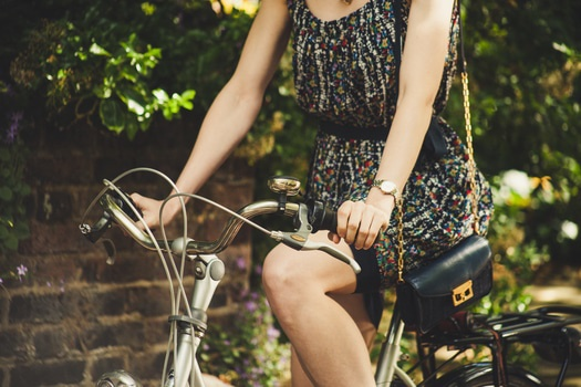 Woman Wearing Black Red and White Scoop Neck Sleeveless Mini Dress While Riding Commuter Bike