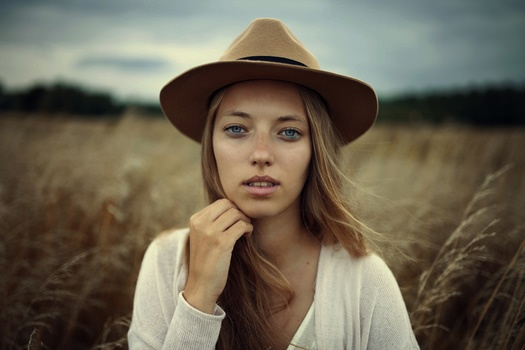 Woman in White Sweater Wearing Brown Cowboy Hat Beside Brown Grass during Daytime