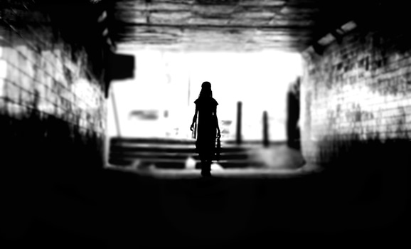 Back of a Woman Silhouette in a Tunnel