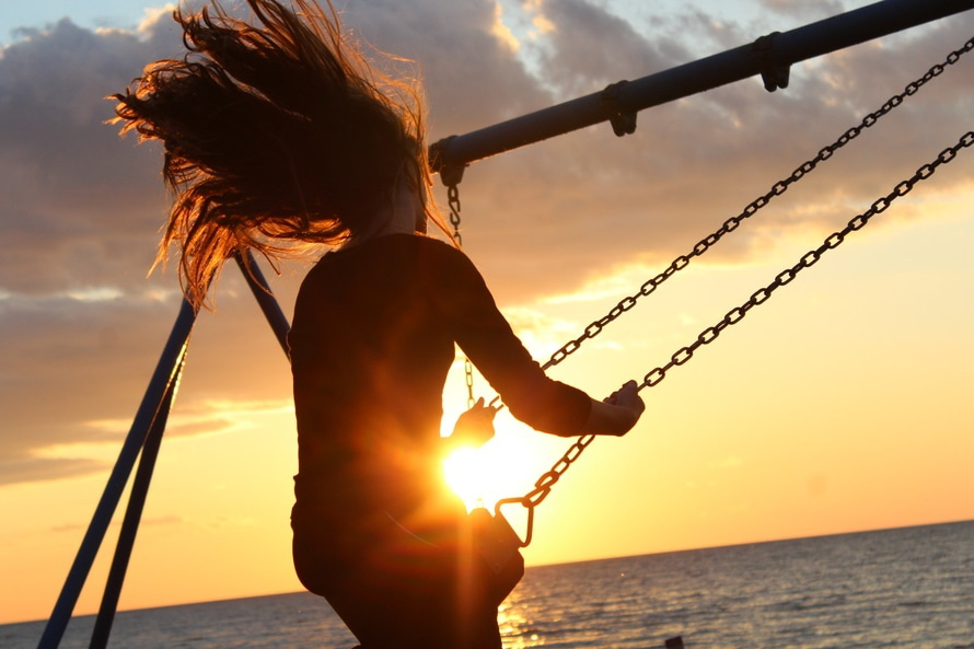 Woman on Swing during Sun Set