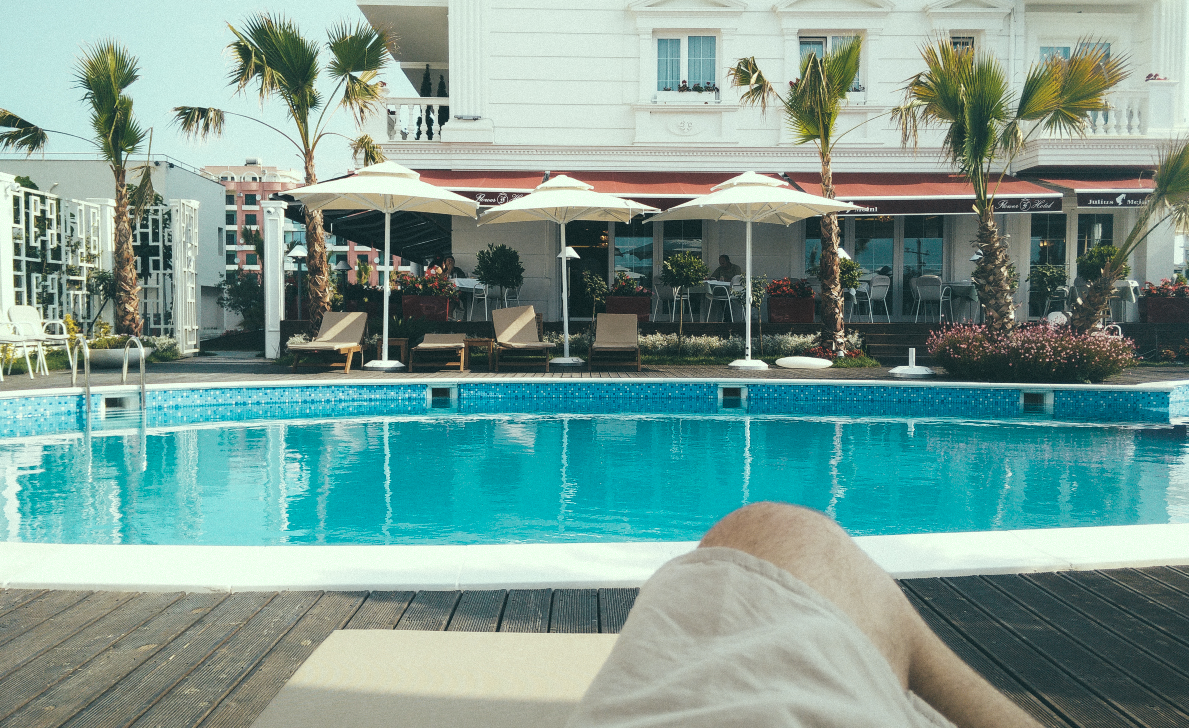 Person Relaxing Near A Swimming Pool Free Stock Photo