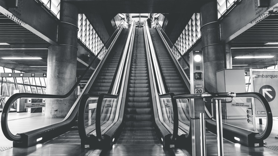 black-and-white, building, escalators