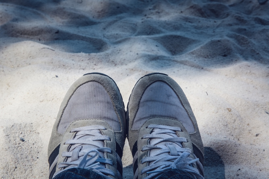 Grey Shoes on Top of Grey Sand
