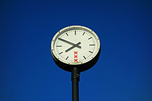 White and Black Round Top Analog Pedestal Clock Low Angle View