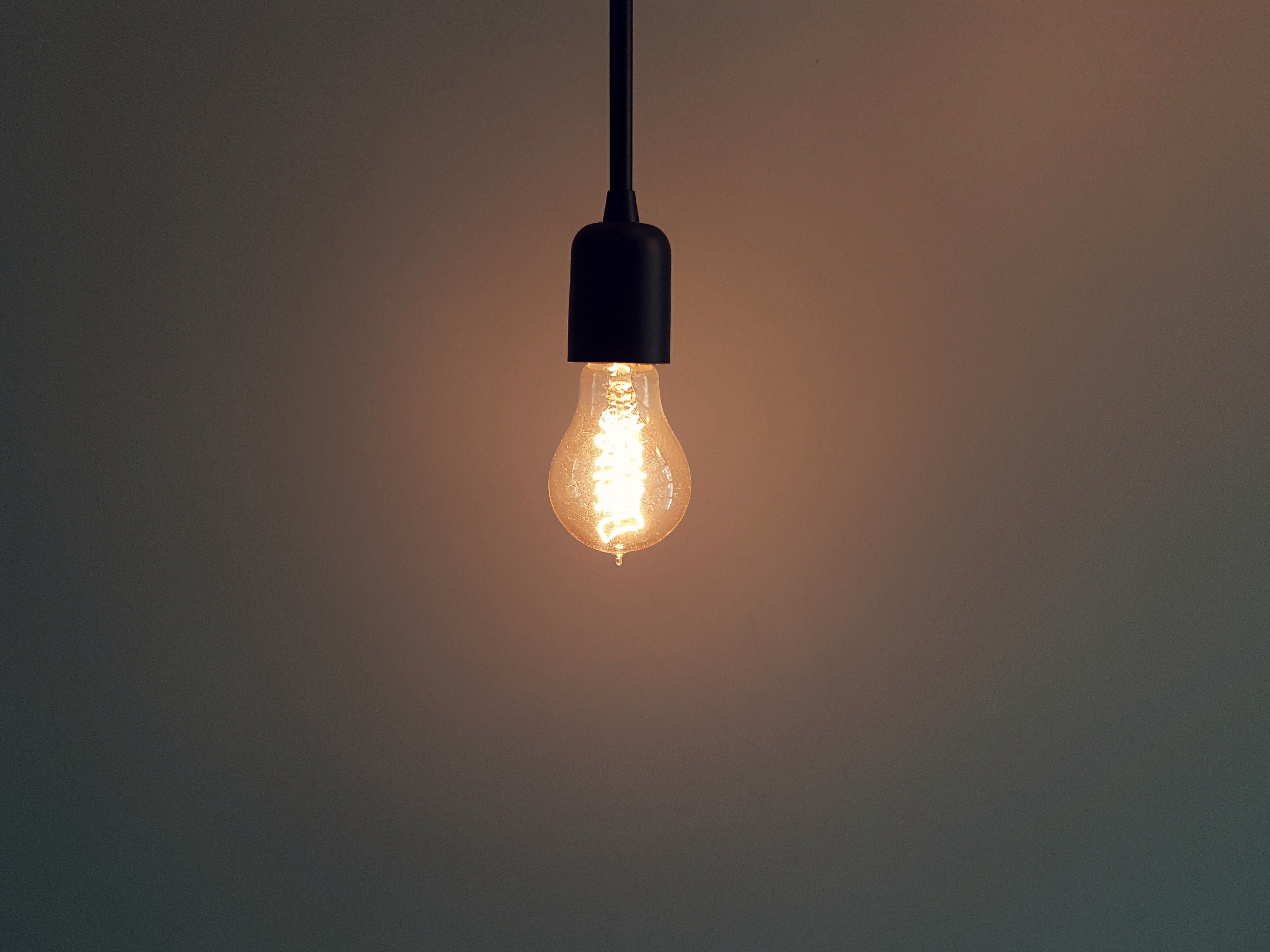 Dark room with light bulb - Turned On Pendant Lamp
