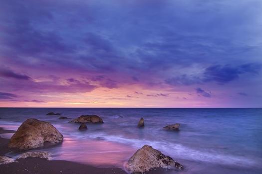 Beige and Black Huge Rock on Seashore