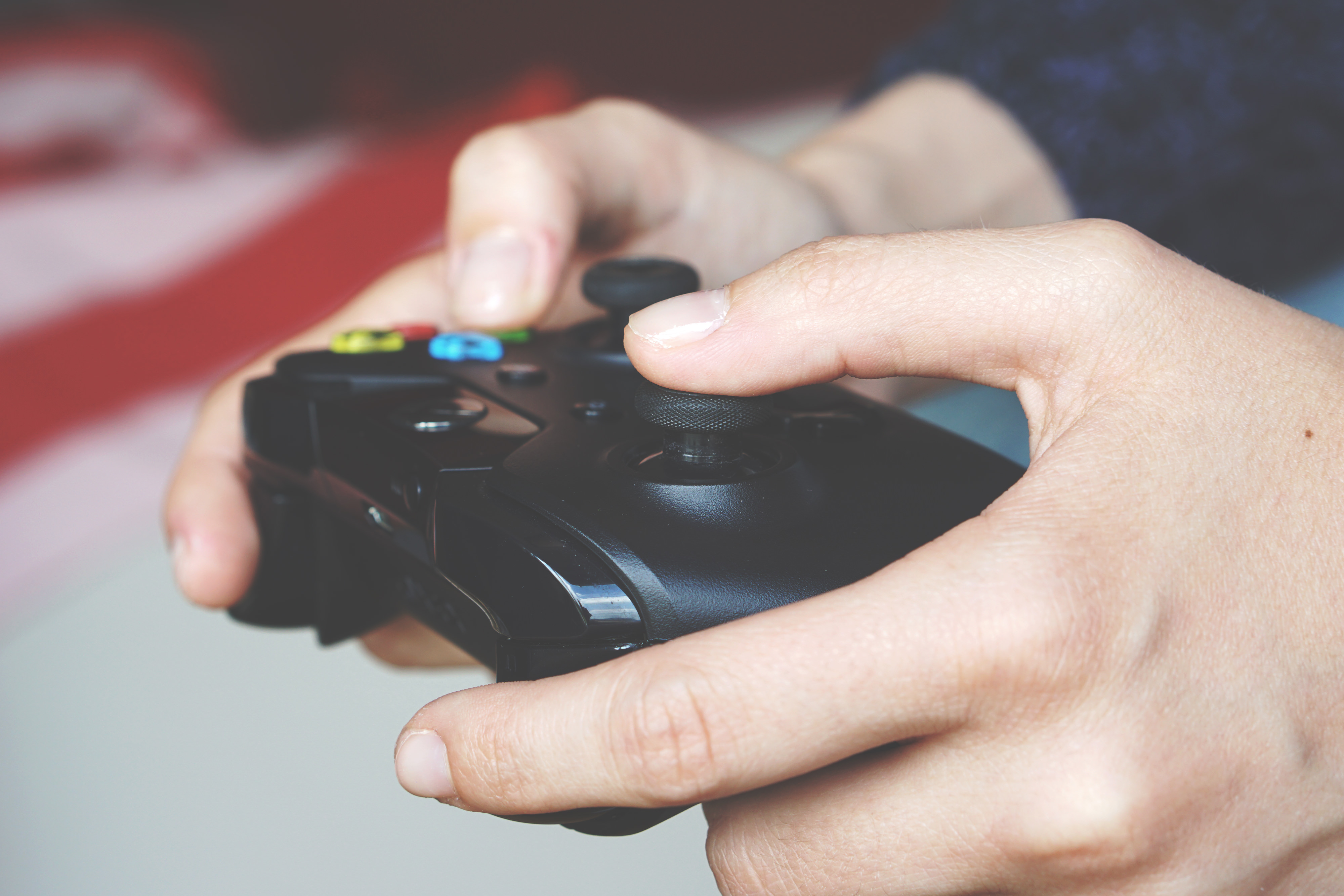Man Holding Black Game Controller