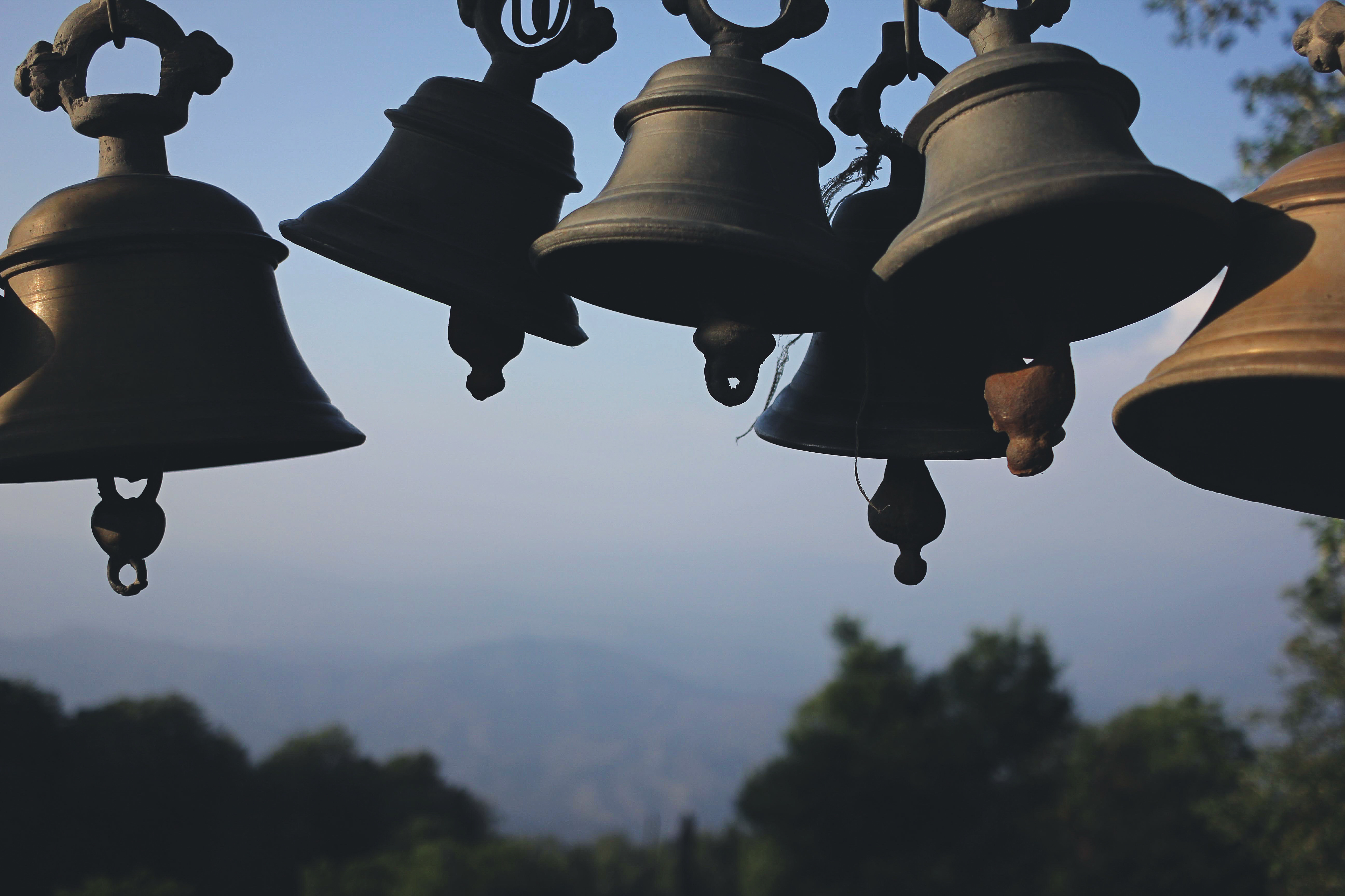 Photography of Black Hanging Bells during Daytime Free Stock Photo