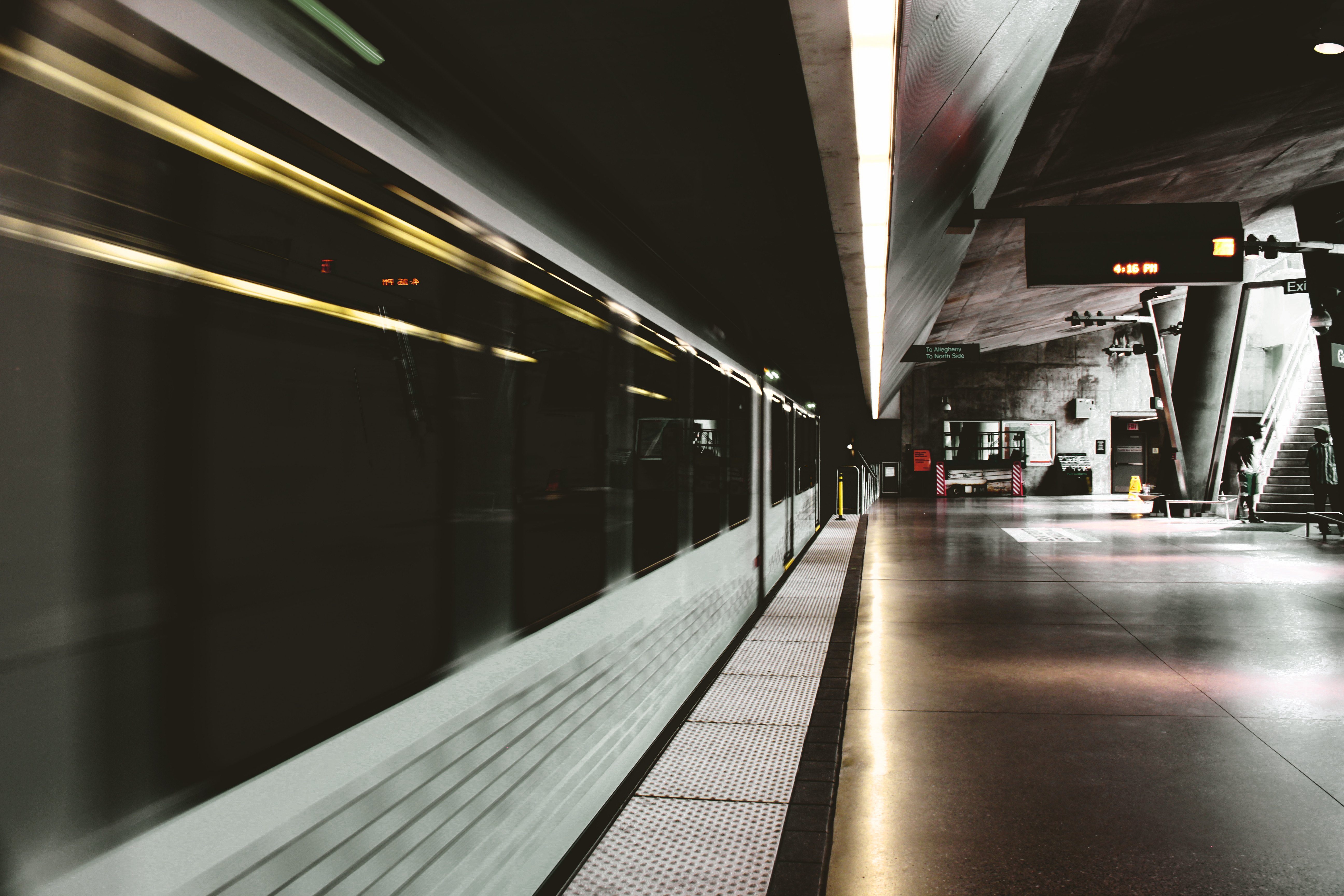 white and black subway train inside station 183 free stock photo
