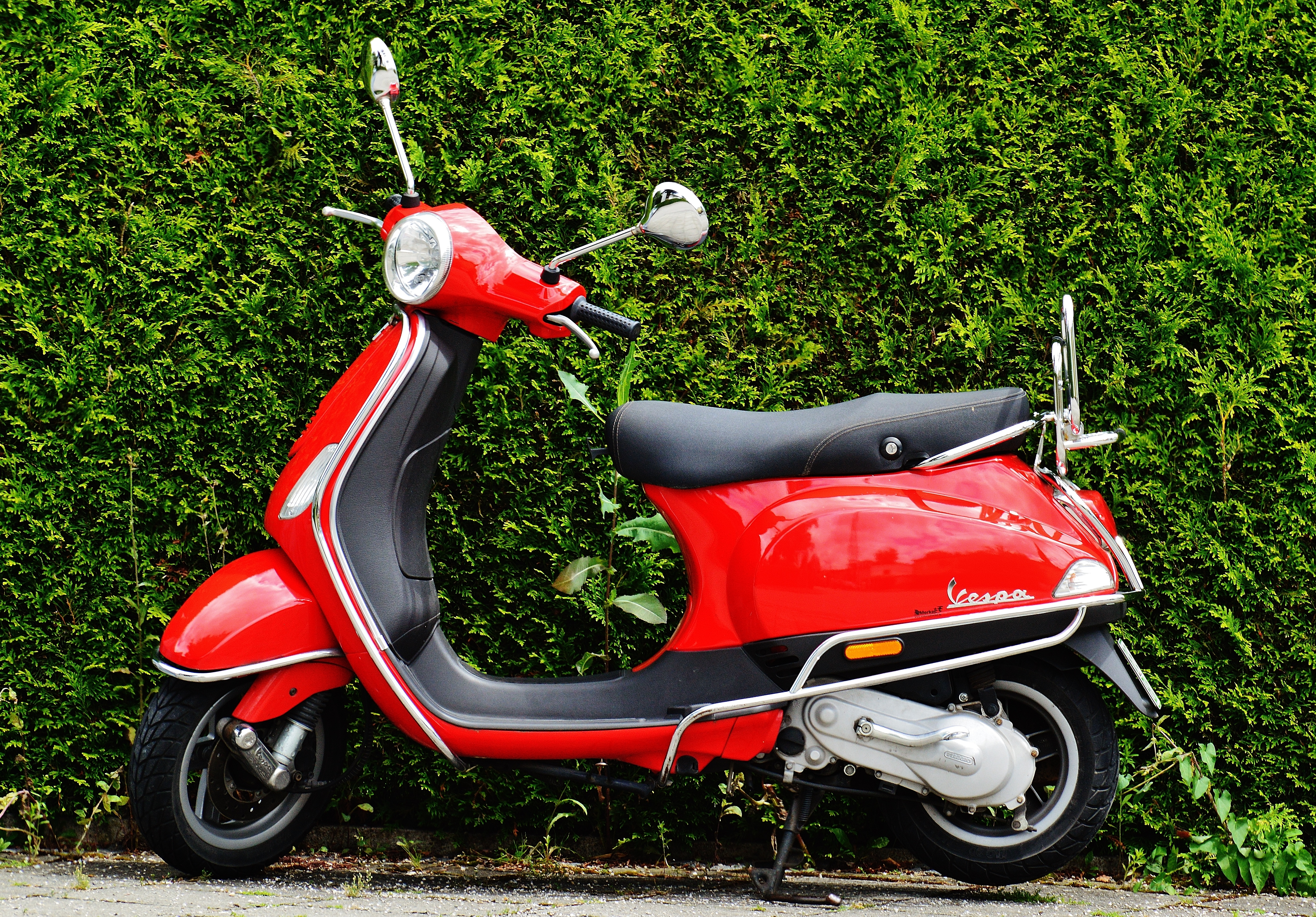red and black moped scooter beside green grass free stock photo. Black Bedroom Furniture Sets. Home Design Ideas