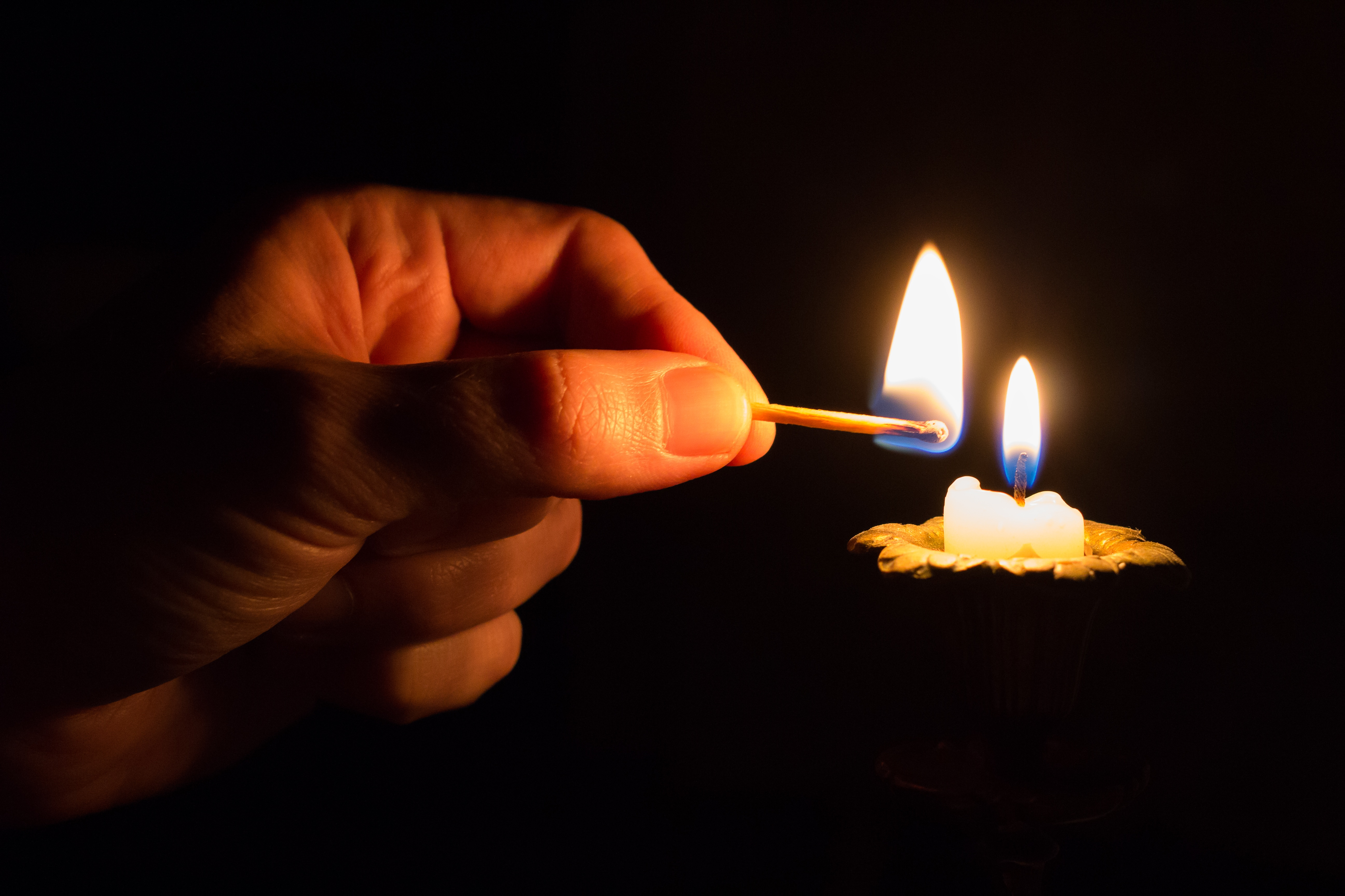 Person Holding Match Stick With Fire in Front of Candle With Fire ... for Holding Candle In The Dark  186ref