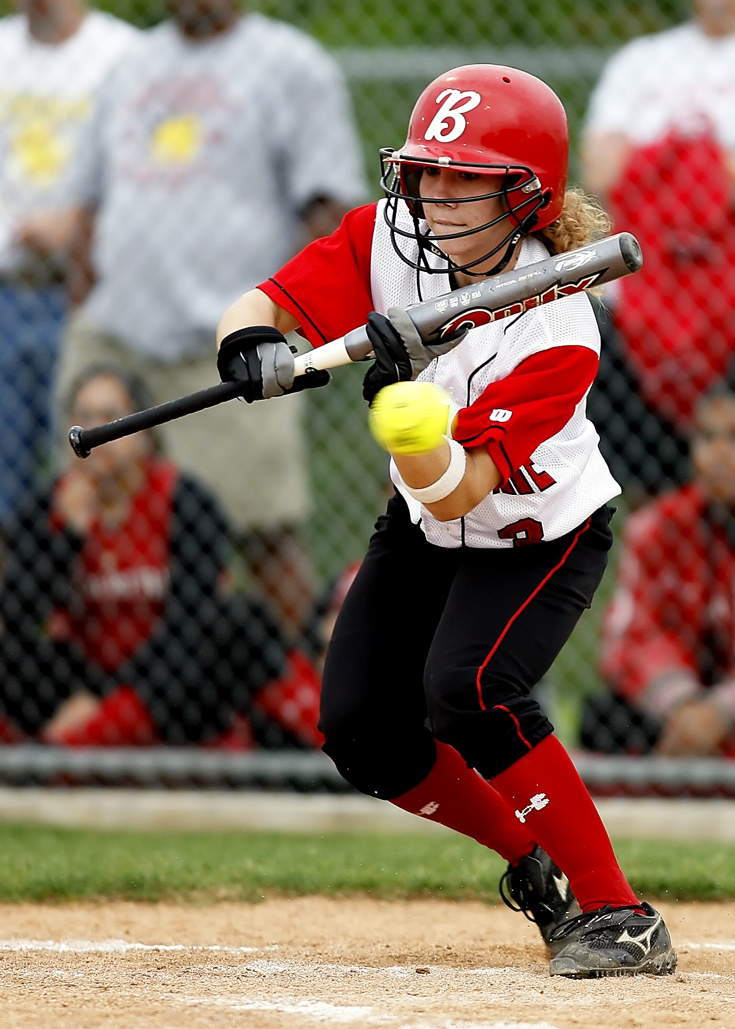 woman holding baseball bat free stock photo