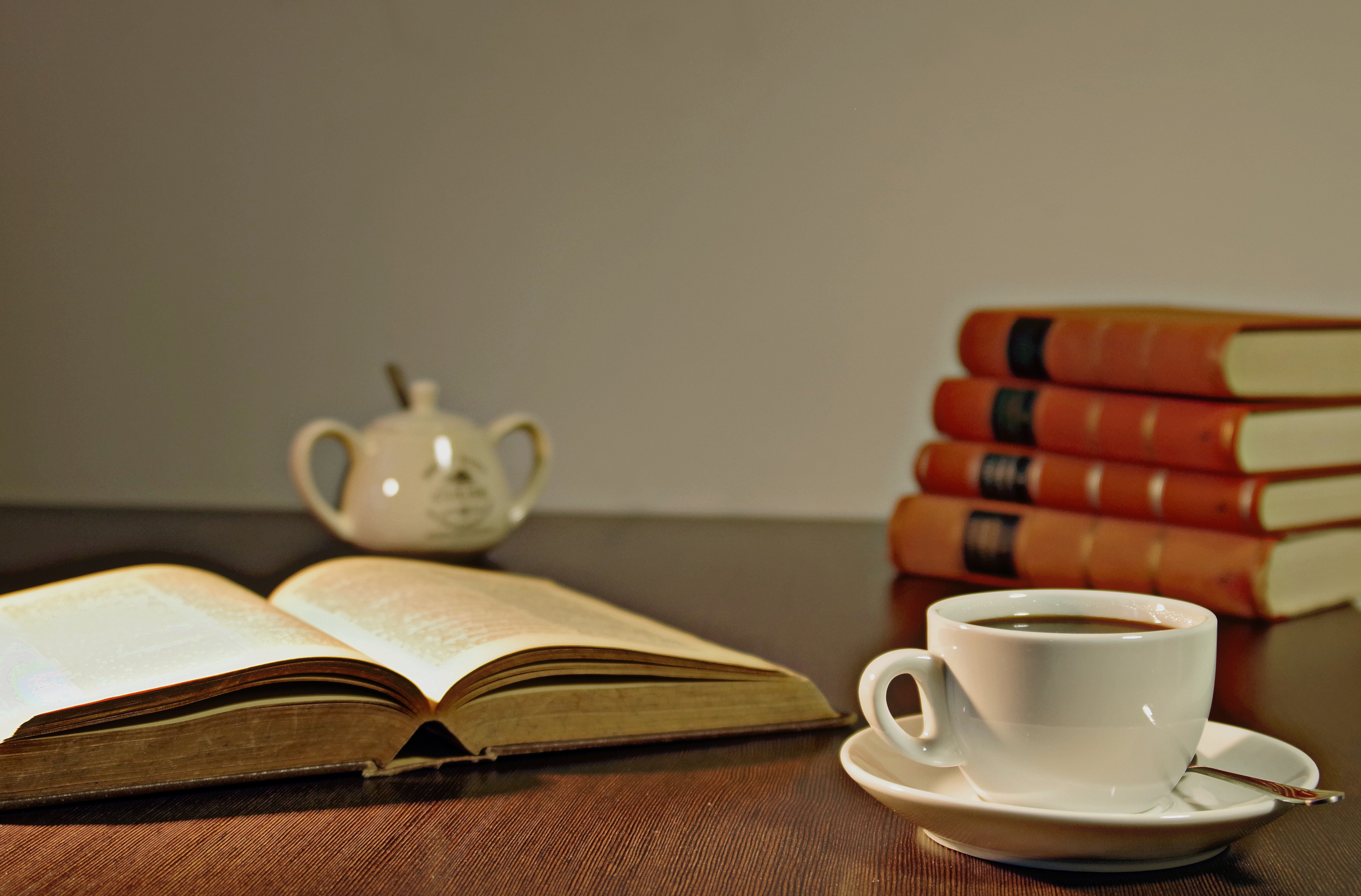White ceramic teacup on brown wooden table beside book free free download geotapseo Gallery