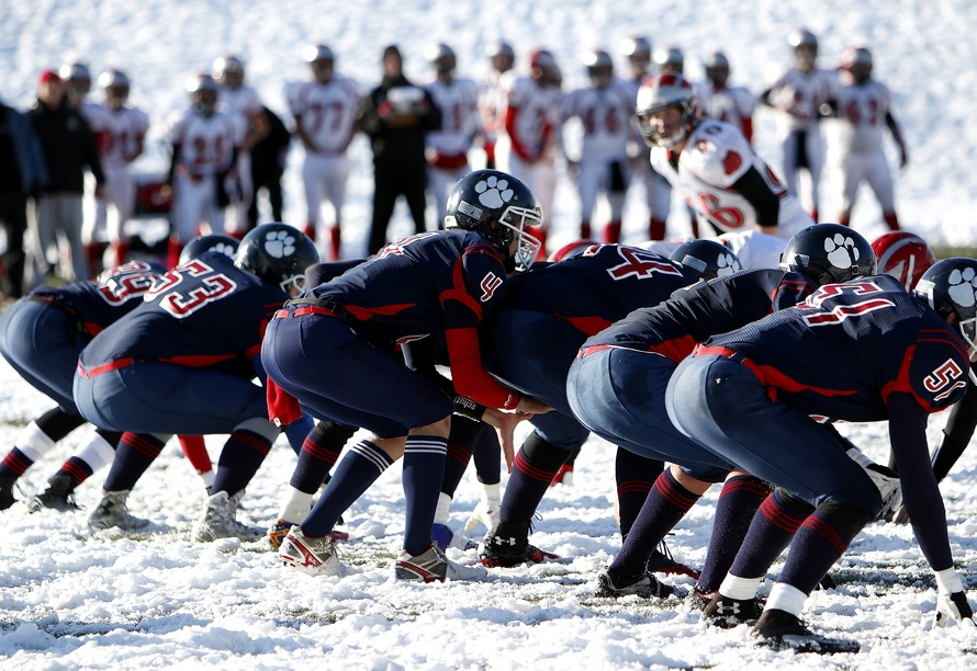 Football Team on Ice during Daytime