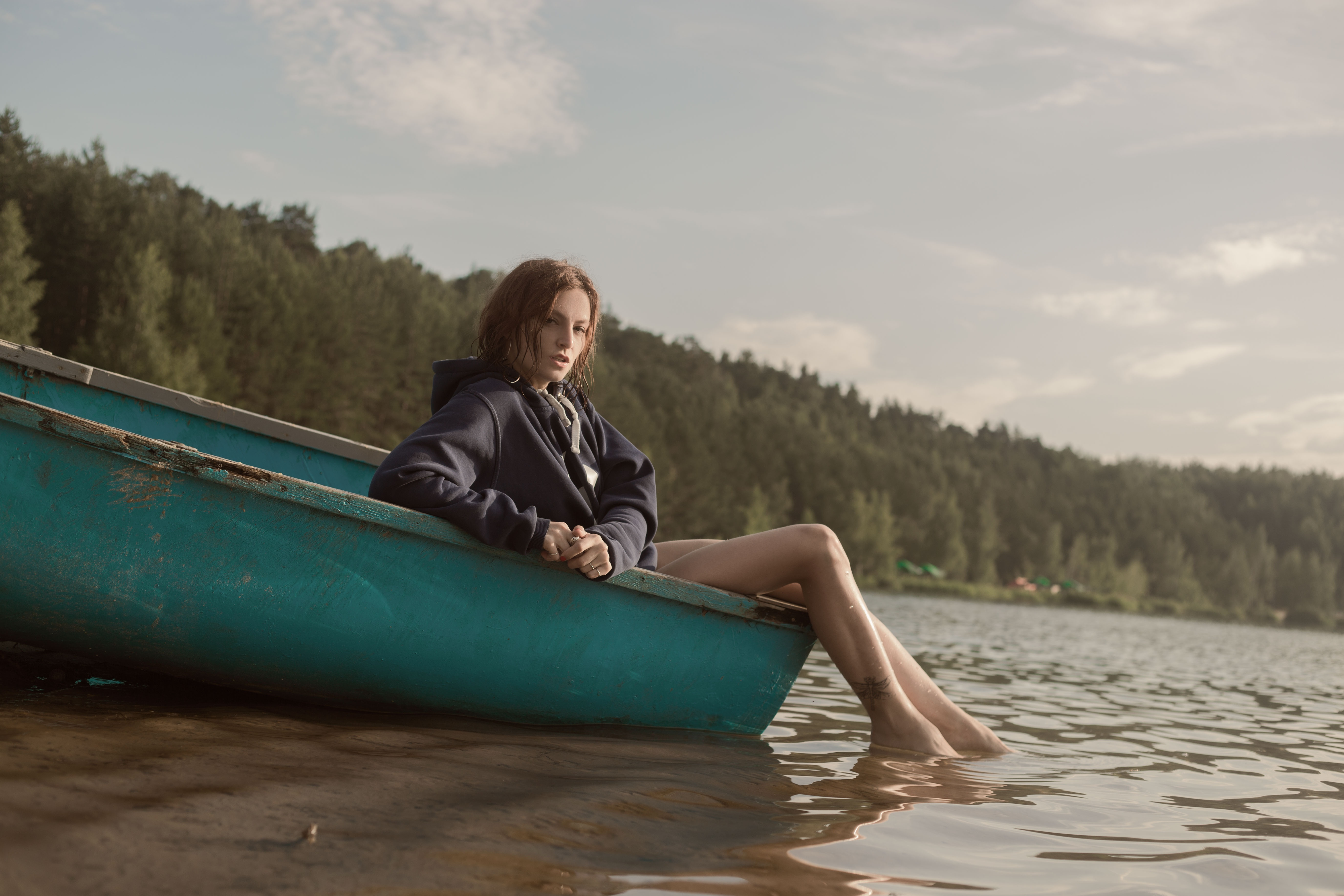 Woman In Black Hoodie Sitting On Blue Kayak 183 Free Stock Photo