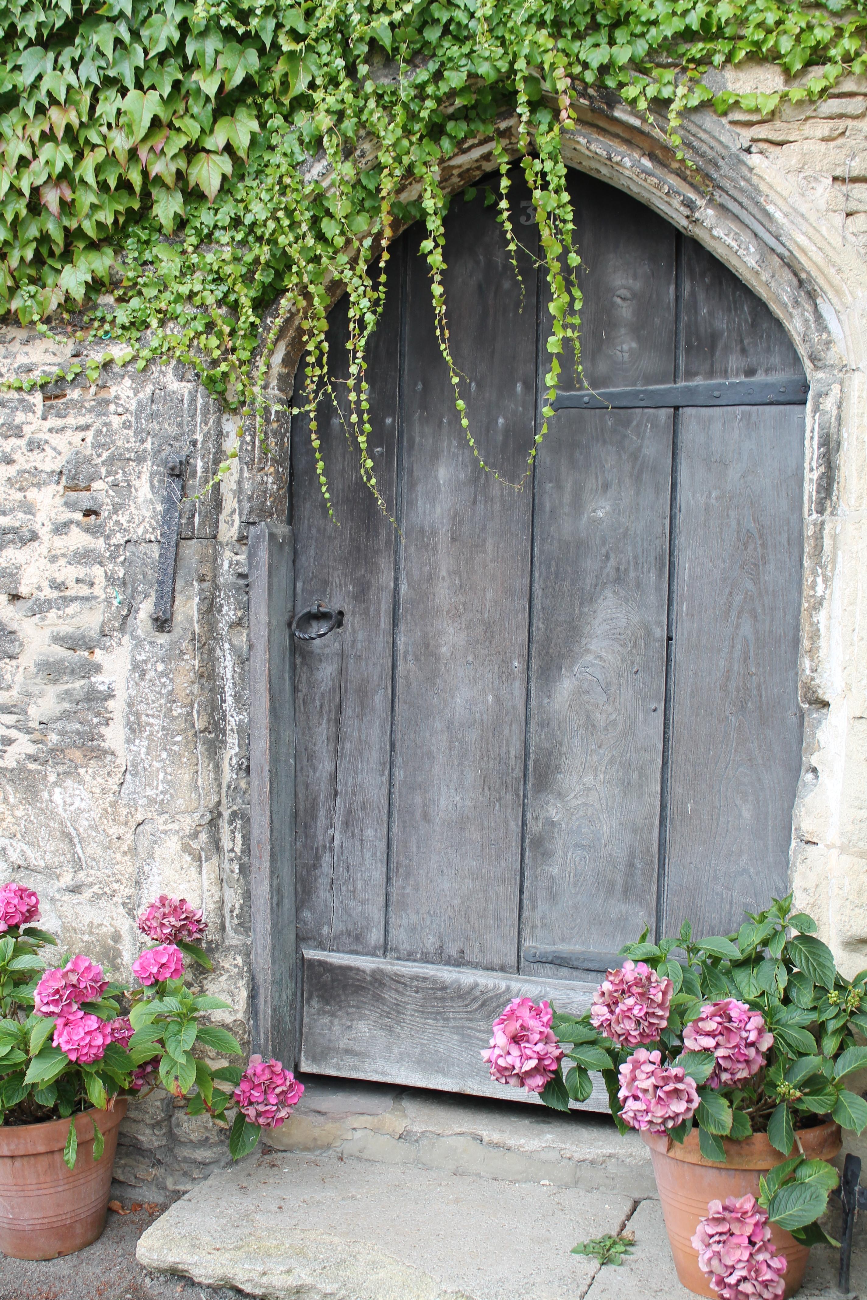 closed brown wooden garden door free stock photo