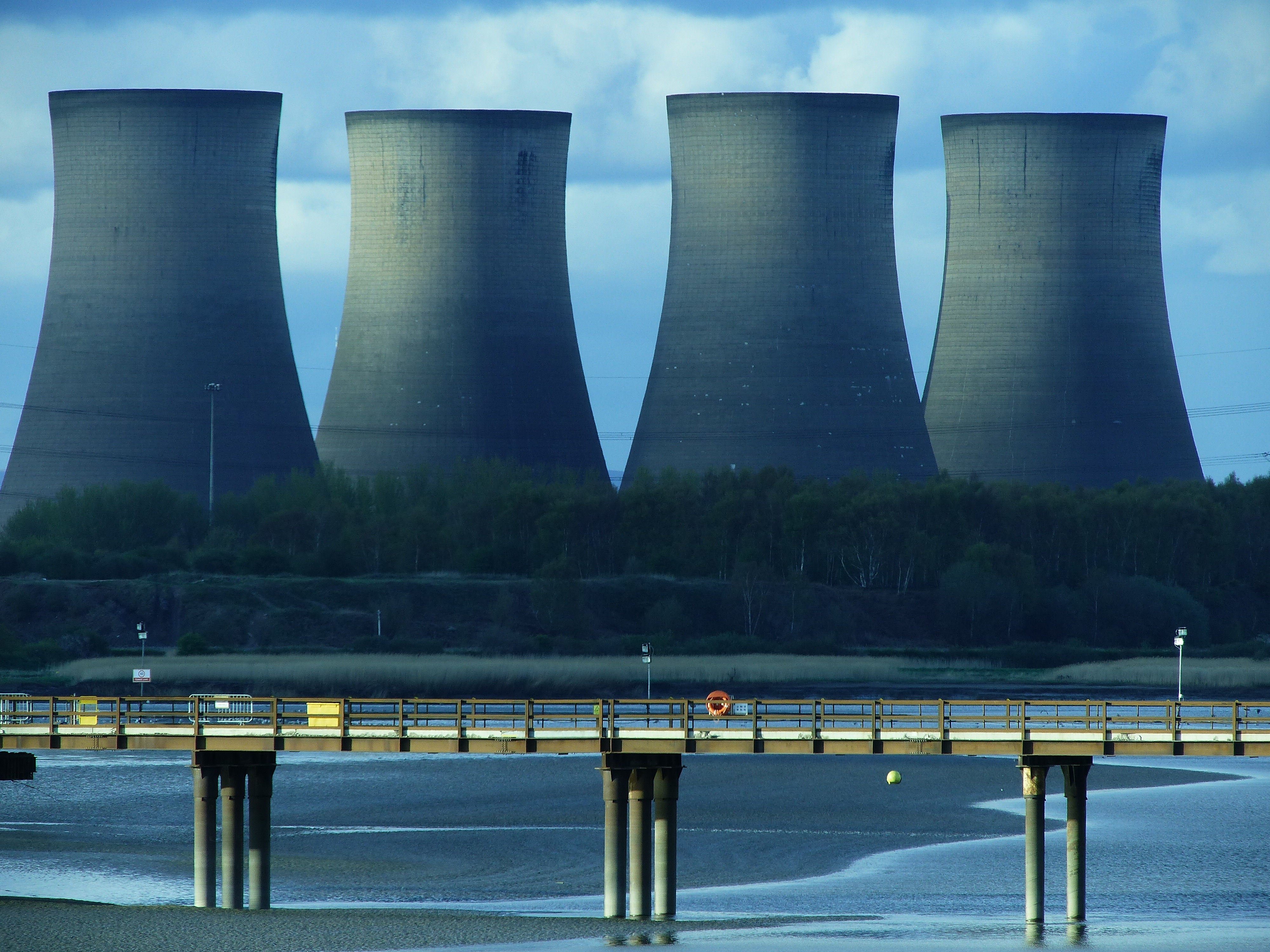 Cooling towers emit steam from a nuclear power generating station.