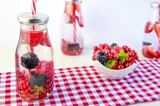 Red Cherry and Grapes on Clear Glass Bottle