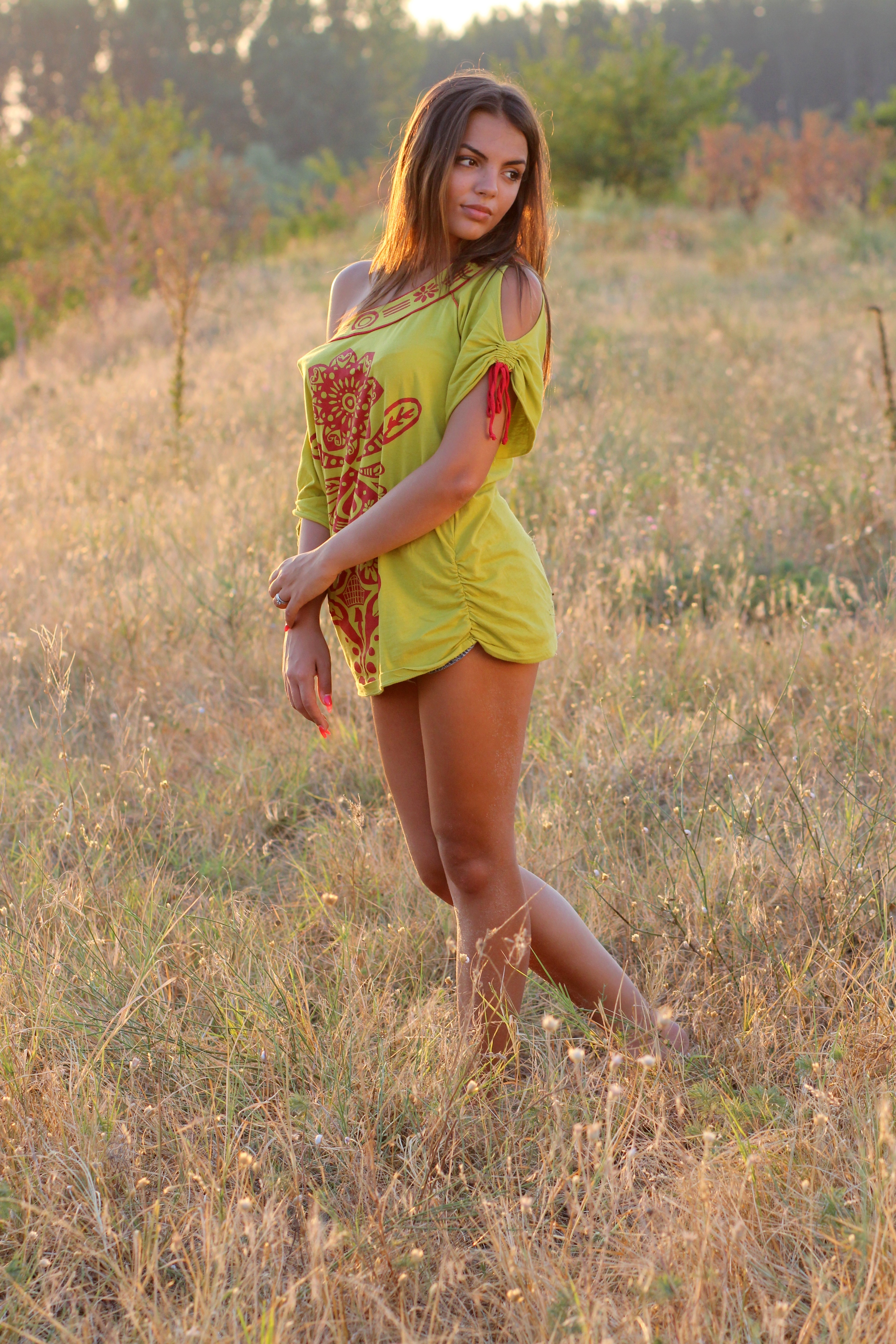 Woman in Yellow Red Floral One Shoulder Shirt Standing on