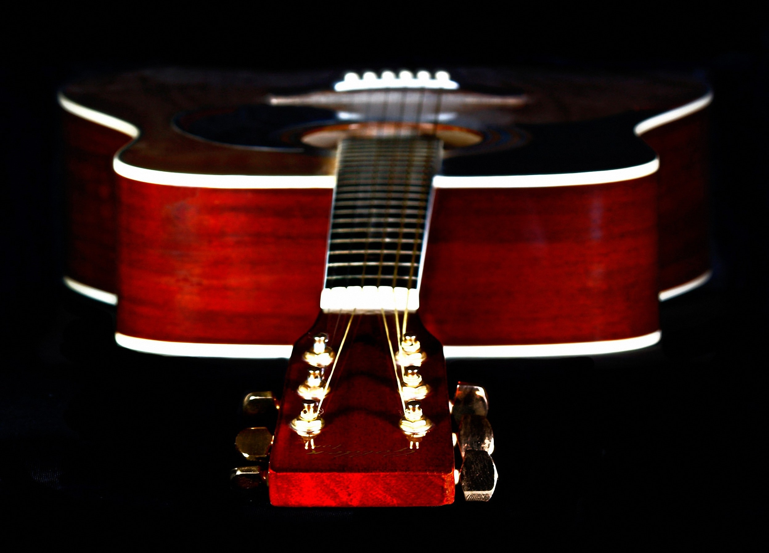 Close Up Photography Of Red Wooden Guitar Head Stock Free