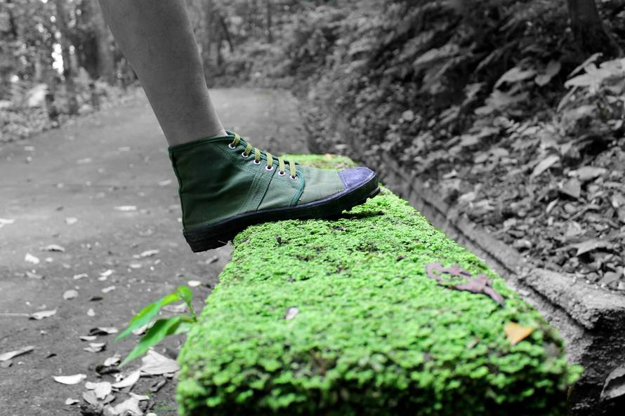 Human Foot and Grass Field Selective Color Footage