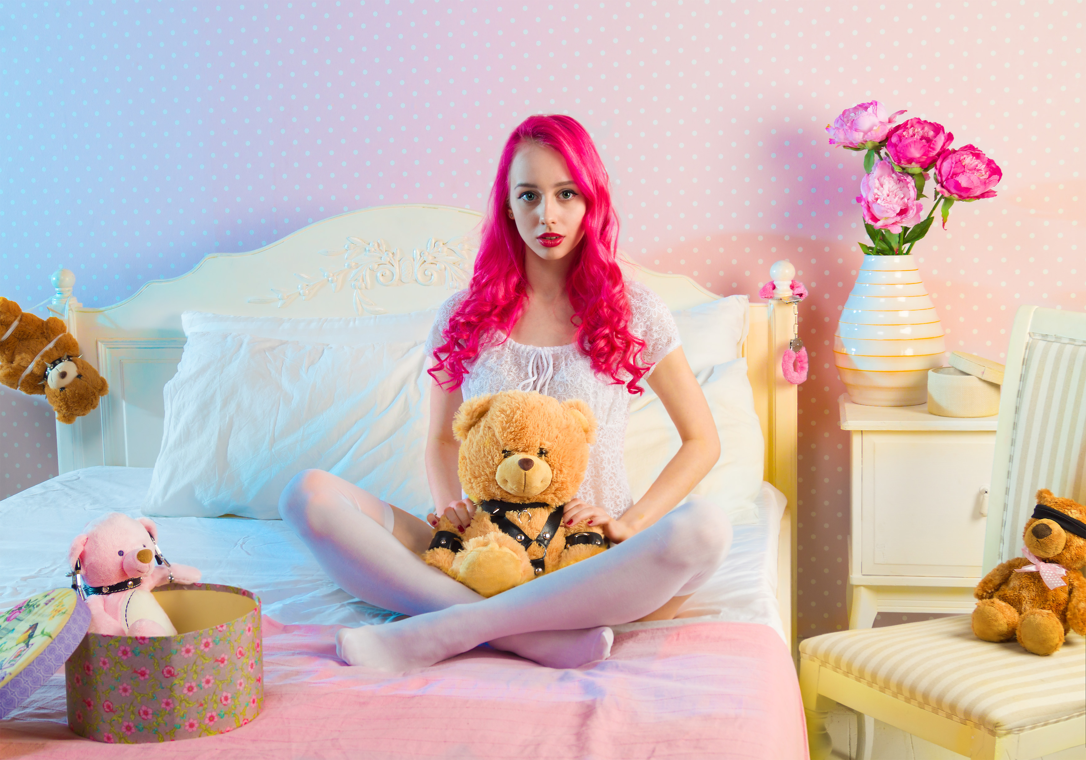 Pink Long Haired Woman Sitting on Double Bed With Bear Plsuh Toy at Daylight · Free Stock Photo