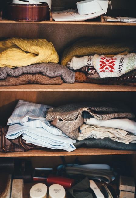 Assorted Garments on Brown Wooden Wardrobe