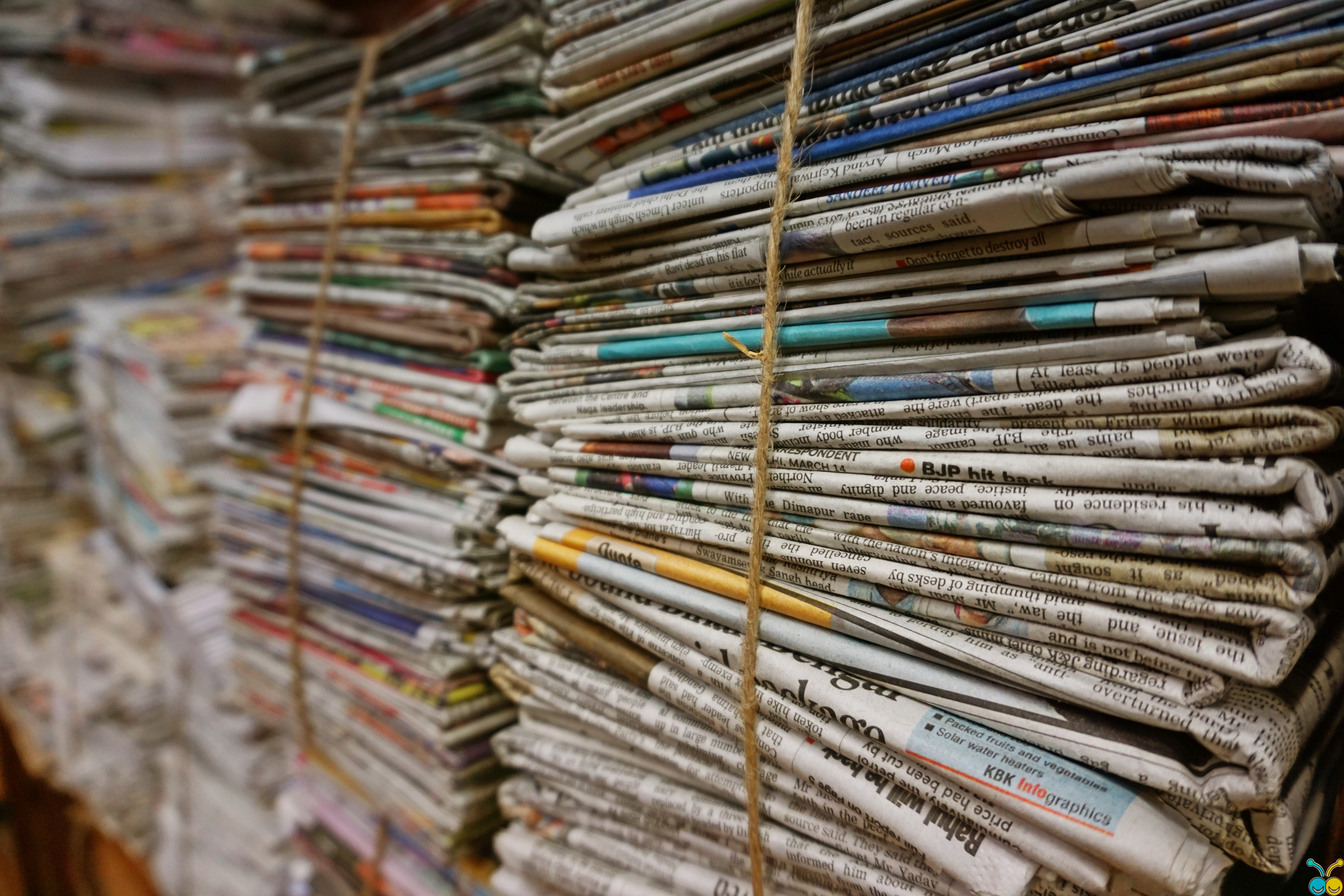 Newspaper stacks to show that some items are weather sensitive.