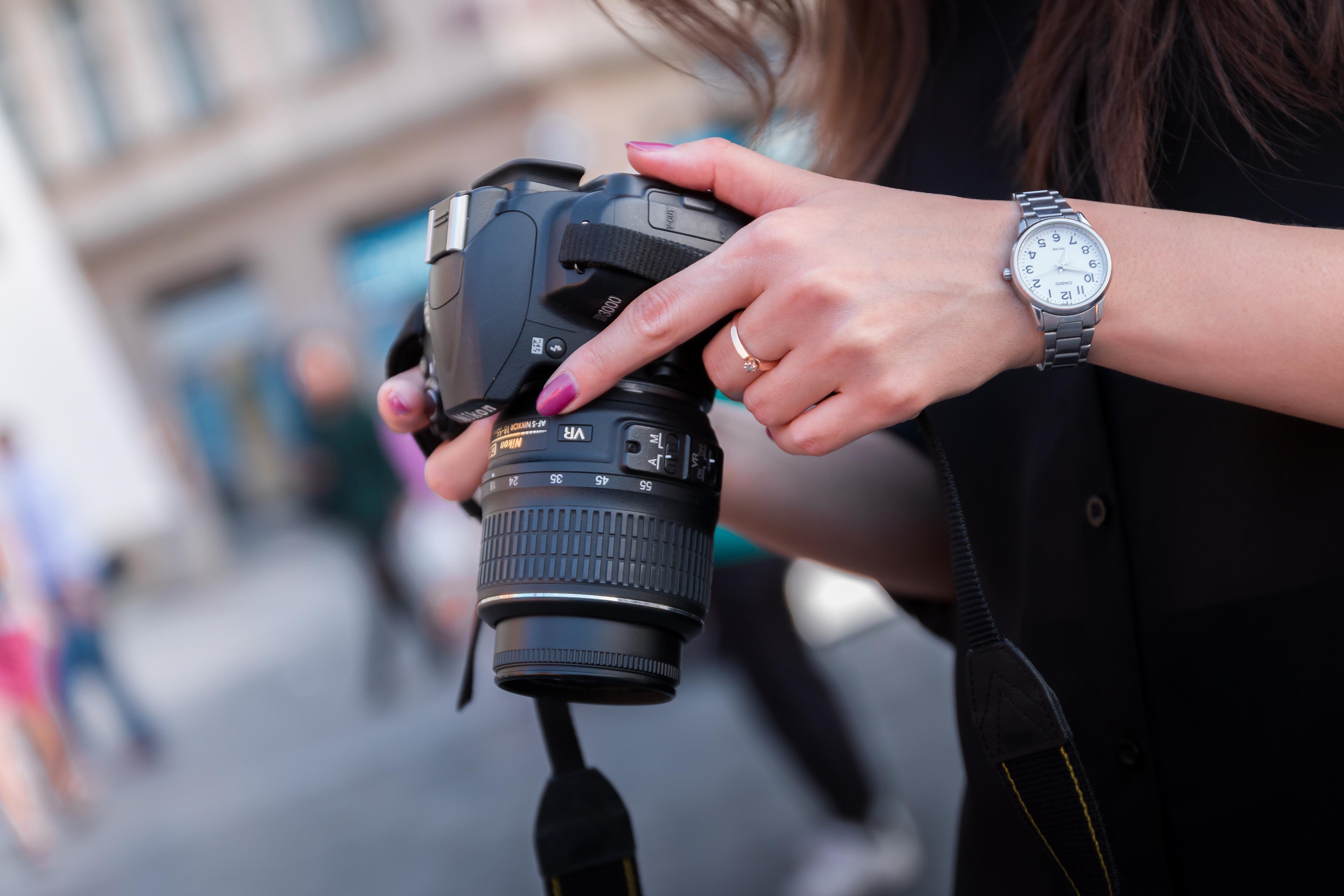 Woman Holding Black Dslr Camera · Free Stock Photo