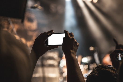 Free stock photo of hands, smartphone, taking photo, festival