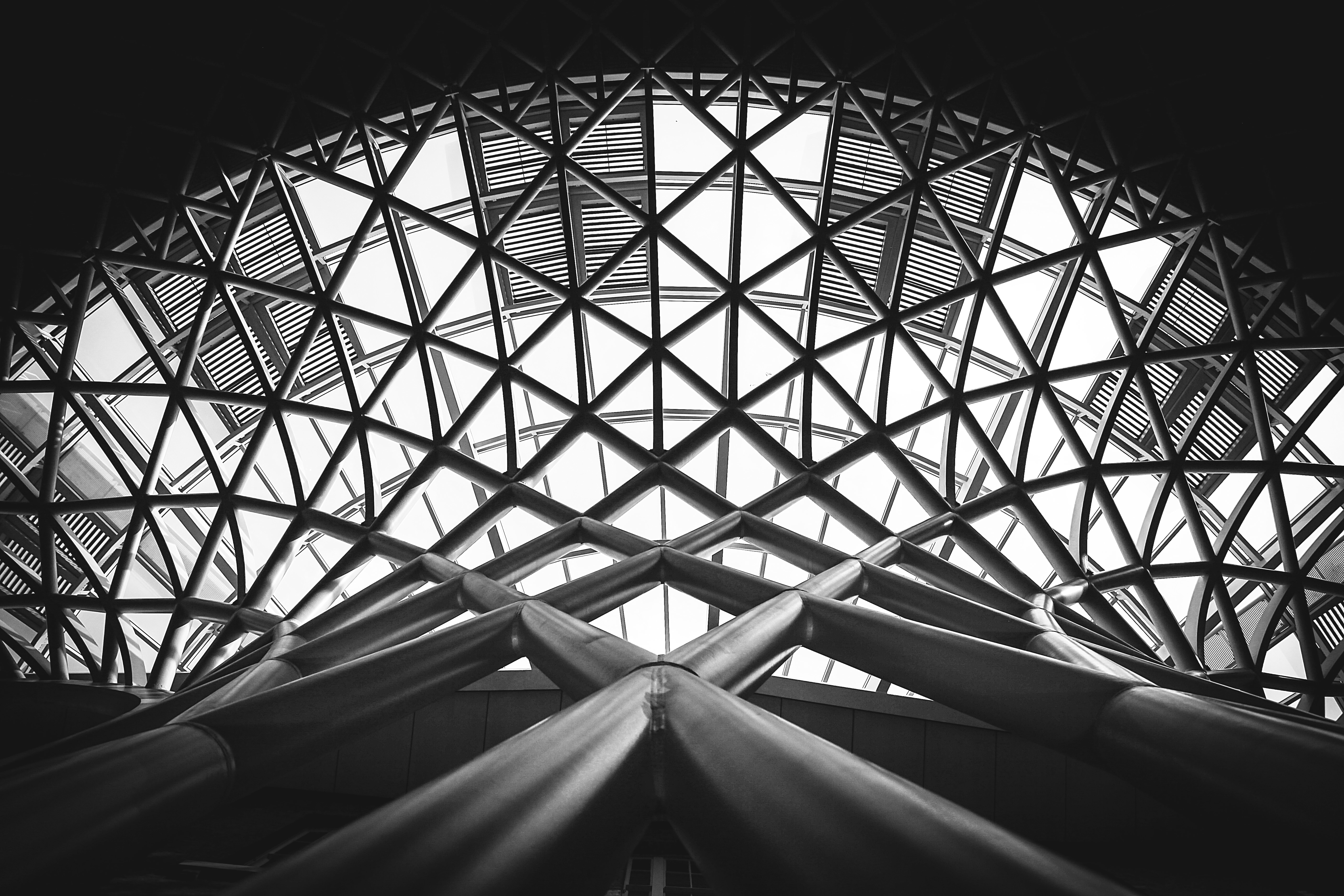 Low angle photography of metal building on grayscale for Structure photography