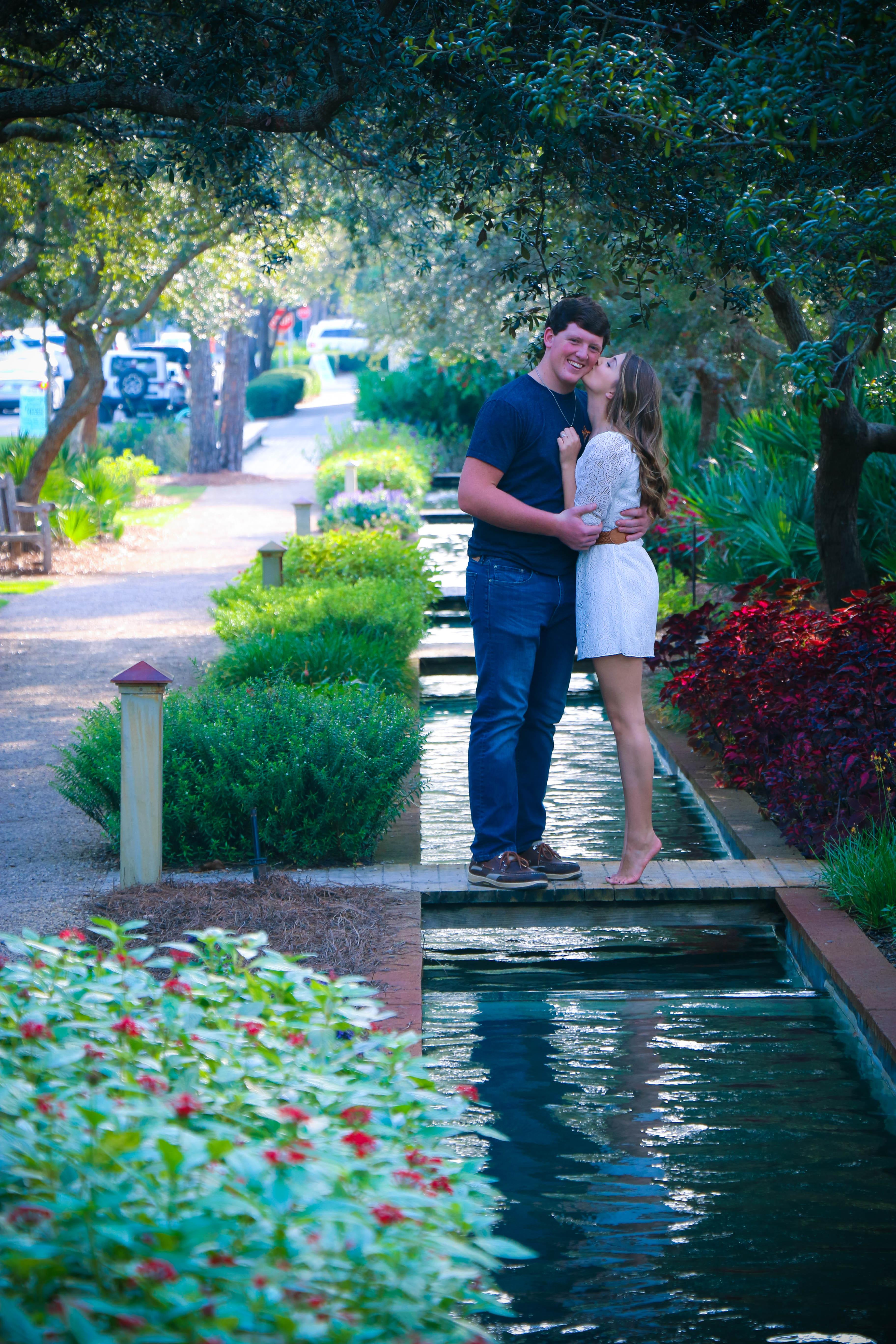 Woman And Man Standing On Bridge Kissing 183 Free Stock Photo