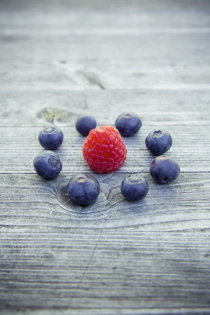 Raspberry Beside Blueberries