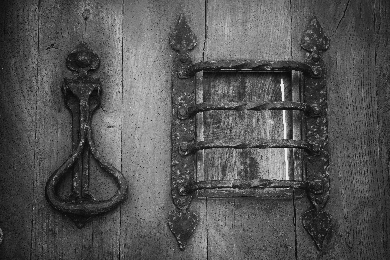 grey metal knocker on brown wooden door free stock photo. Black Bedroom Furniture Sets. Home Design Ideas