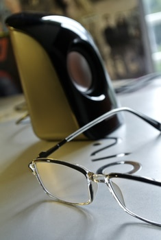 Black Frame Eyeglass Beside Black and White Electric Kettle