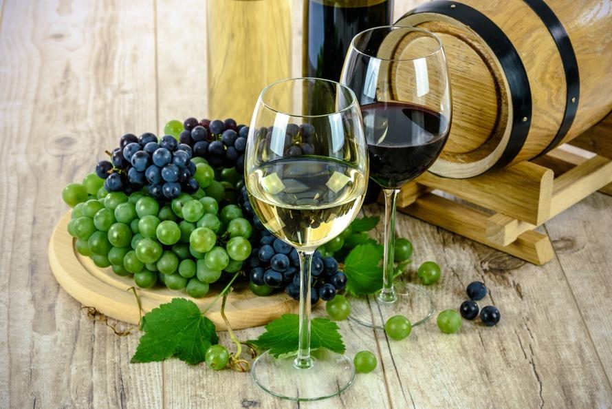 Clear Wine Glass Near Green Grapes
