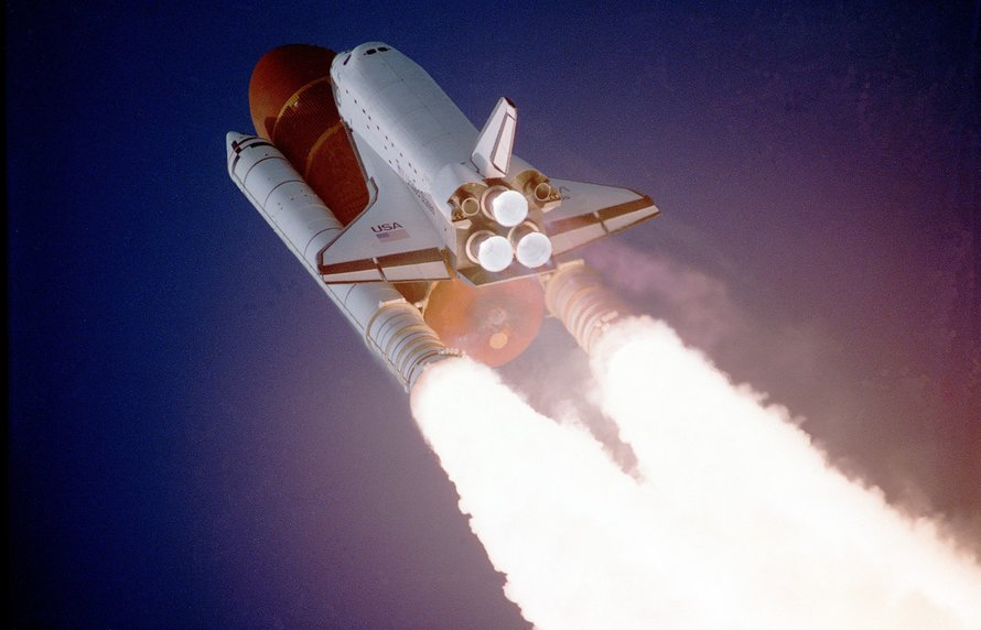 a photo of a USA space shuttle launching on a rocket.