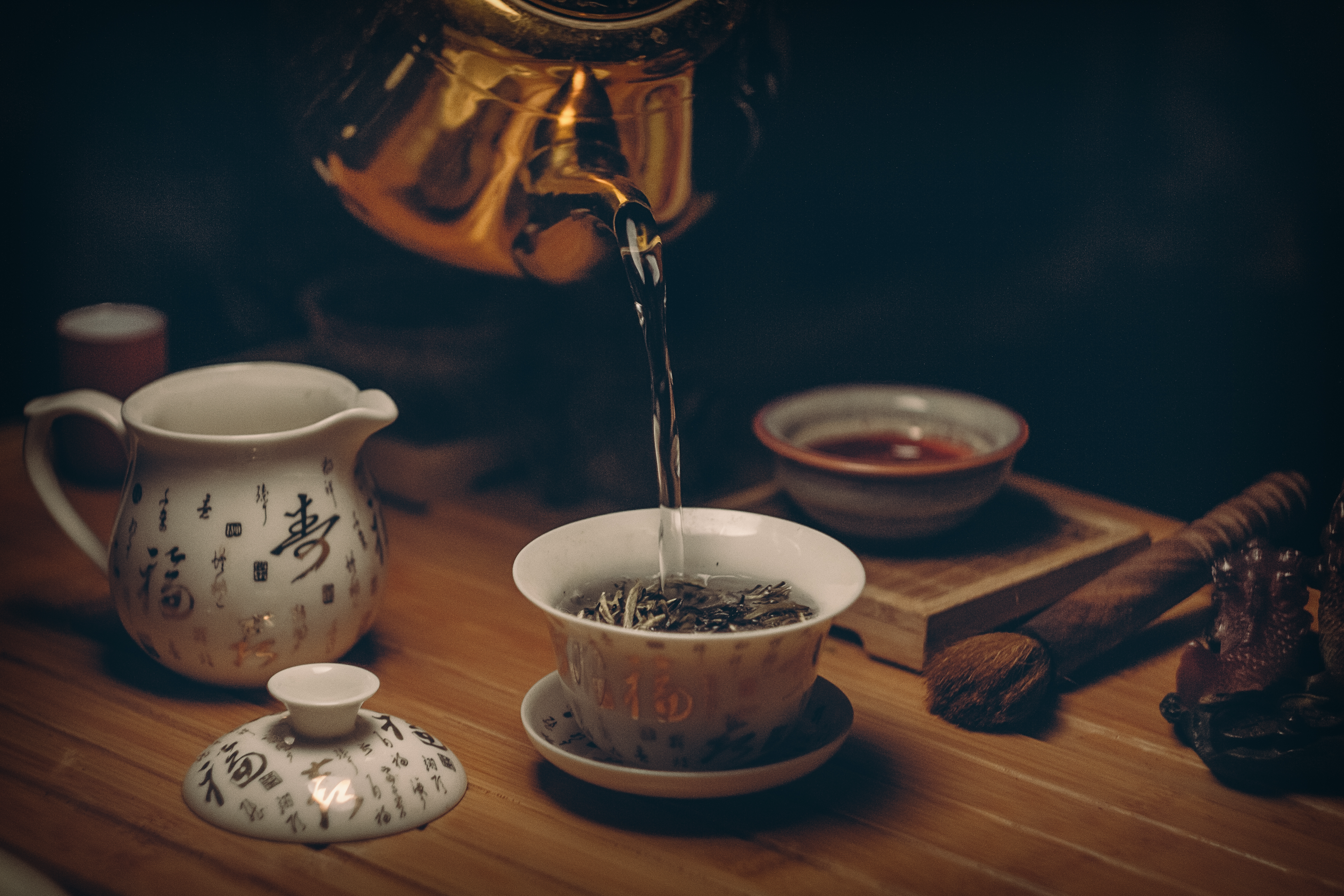 Photographystockphoto photographystockimages photographystock picture - Gold Kettle Pouring Hot Water On Cup Of Tea