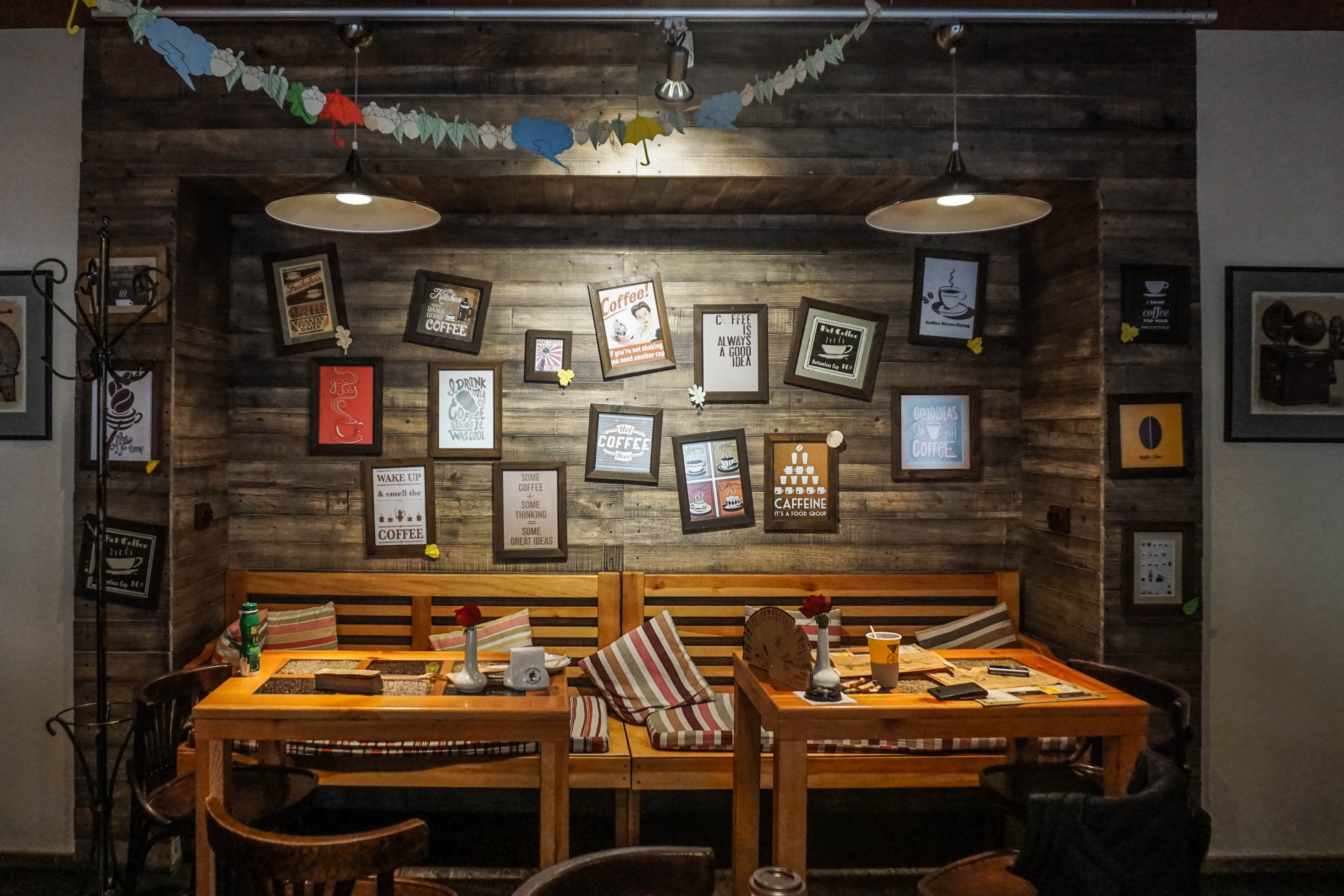 dinning tables near wall with photo frame decor free