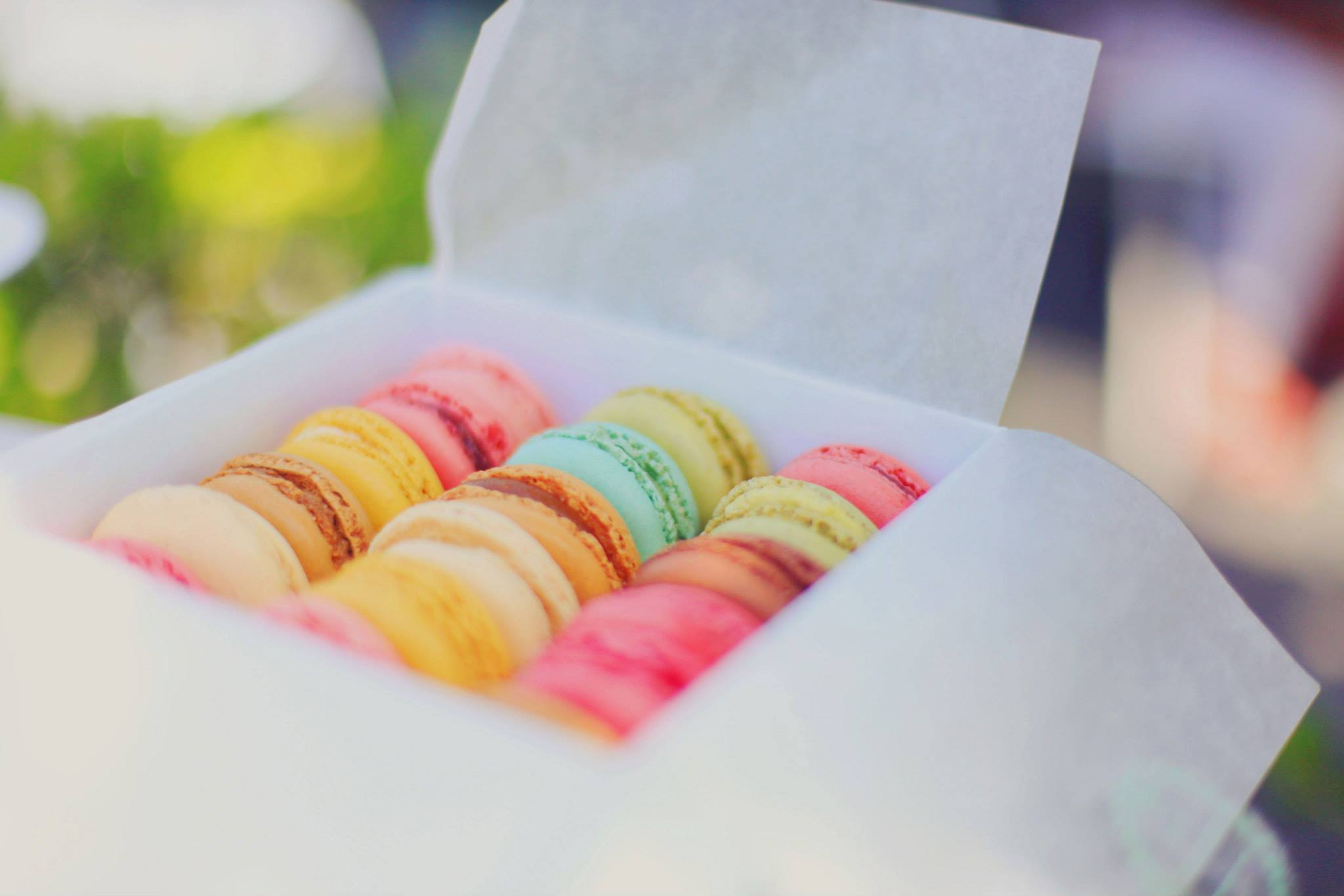 box of macarons in bright colors