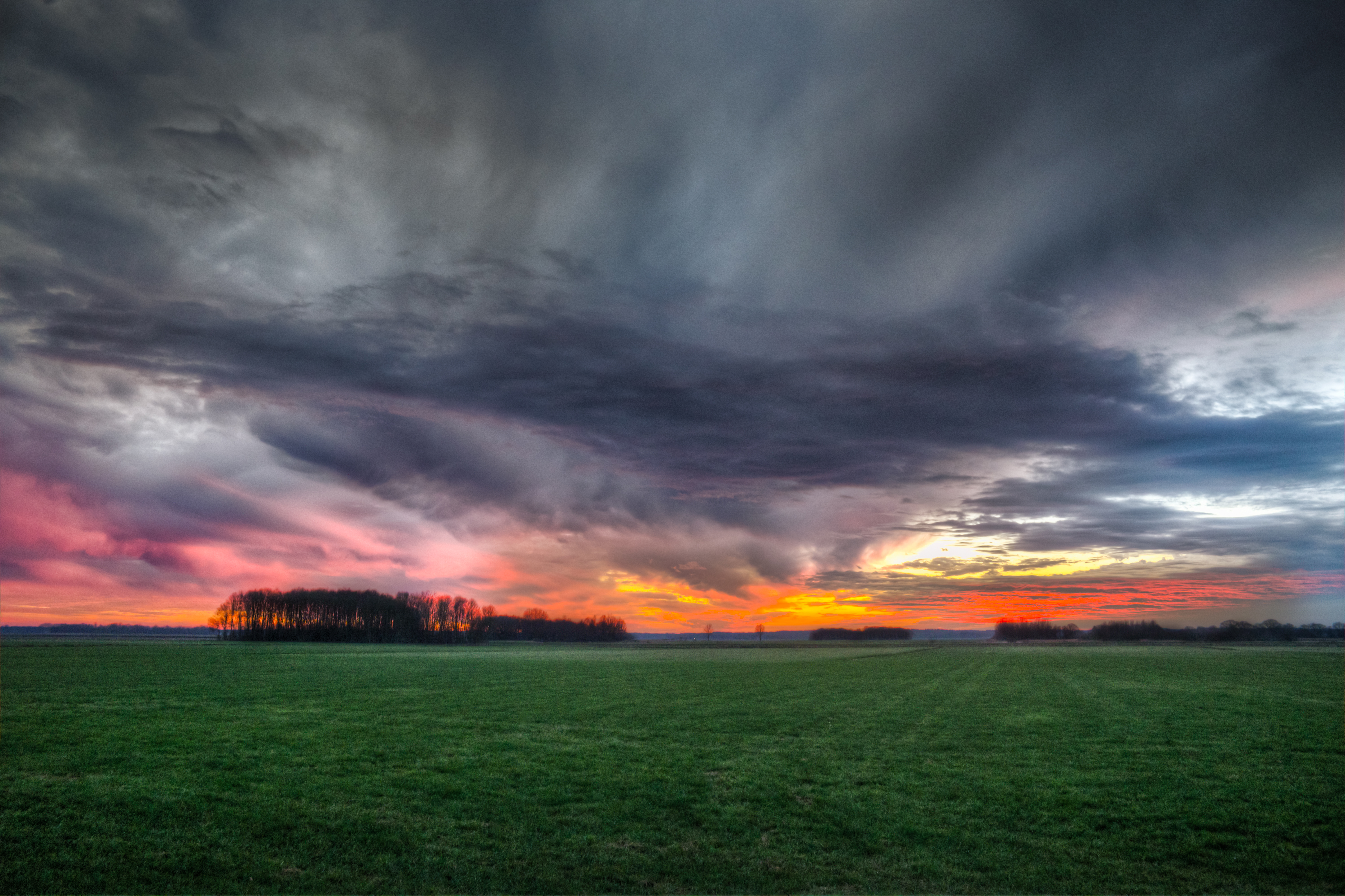 Storm Clouds Over Field During Sunset 183 Free Stock Photo