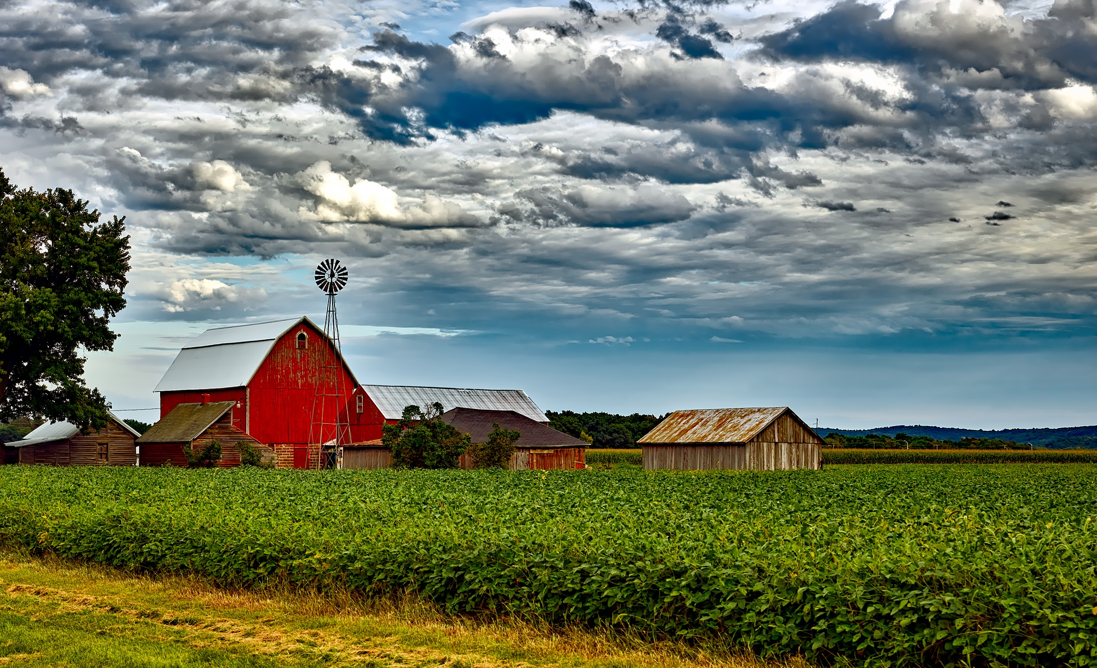 Houses in farm against cloudy sky free stock photo for Farmhouse wallpaper