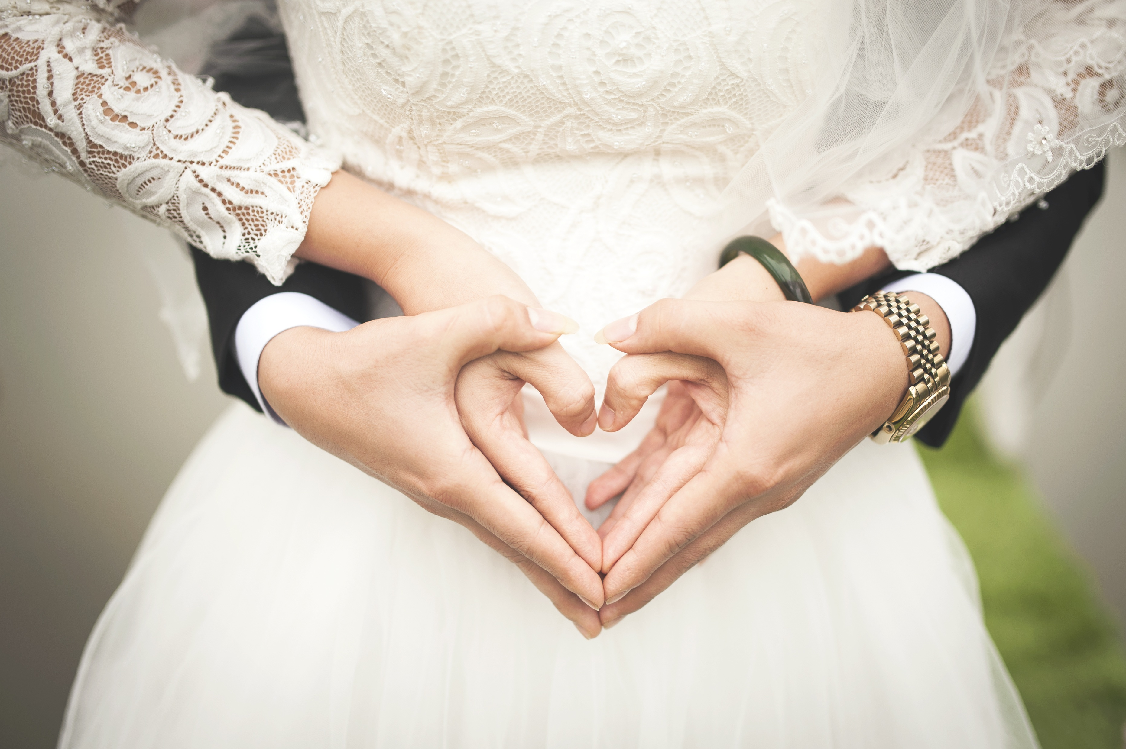 Free stock photos of wedding pexels midsection of woman making heart shape with hands junglespirit