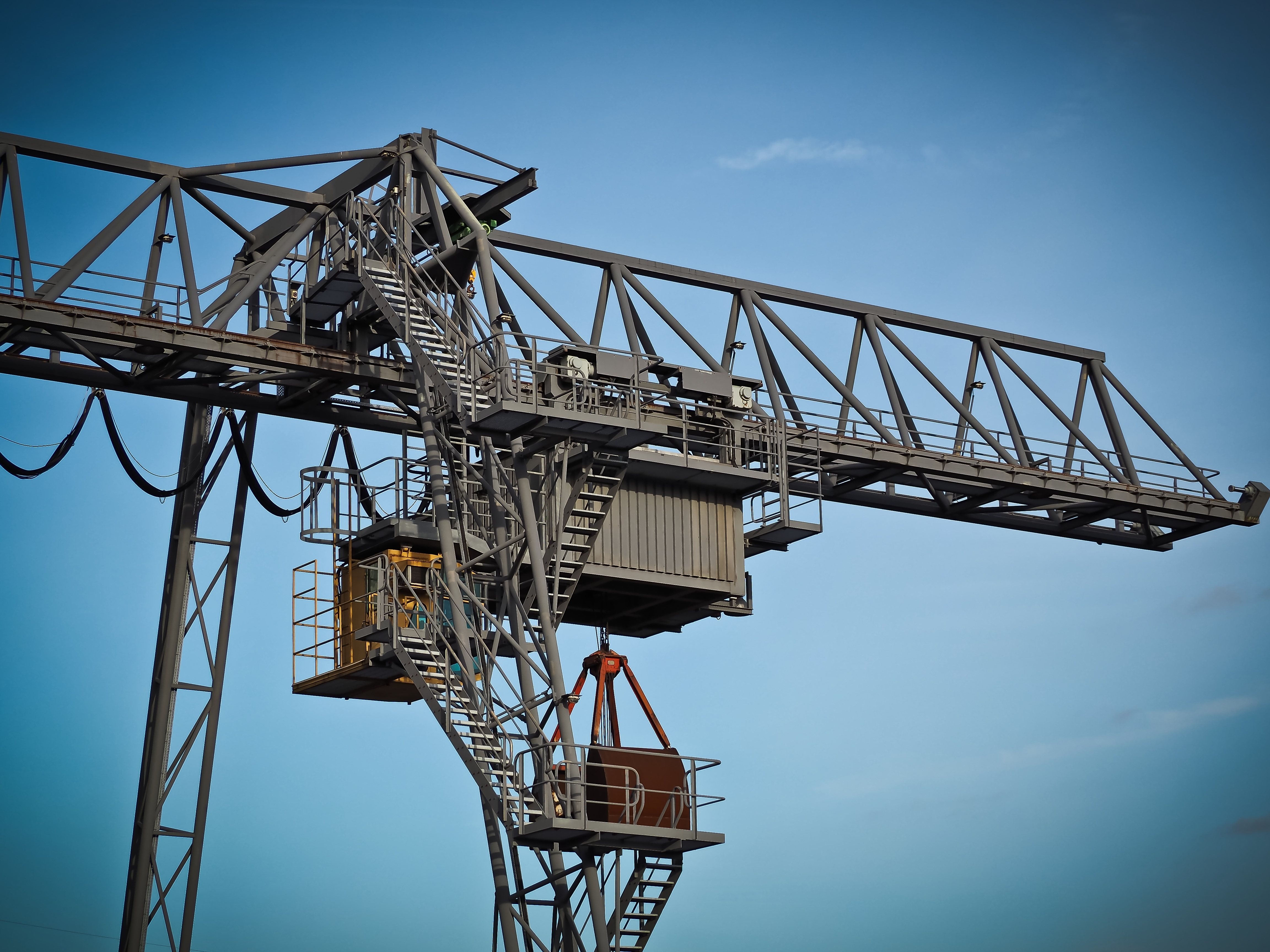 crane against clear sky free stock photo